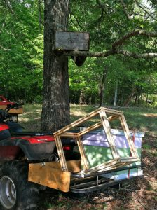ATV with beekeeping equipment to harvest a swarm from a bait hive