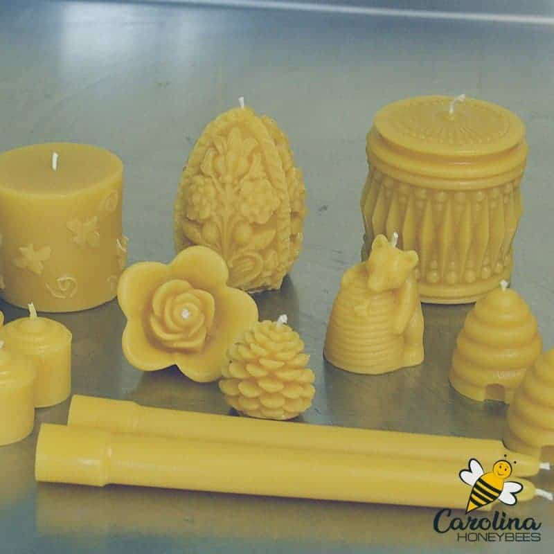 variety of beeswax candles in different shapes