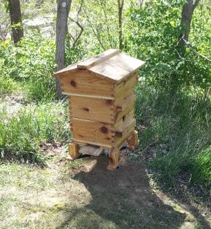 One type of beehive used by natural beekeepers is the warre beehive