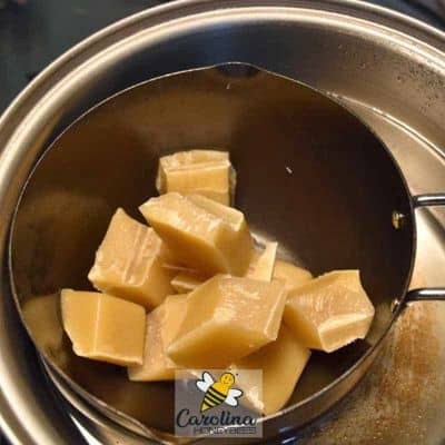 chunks of beeswax melting in a pot