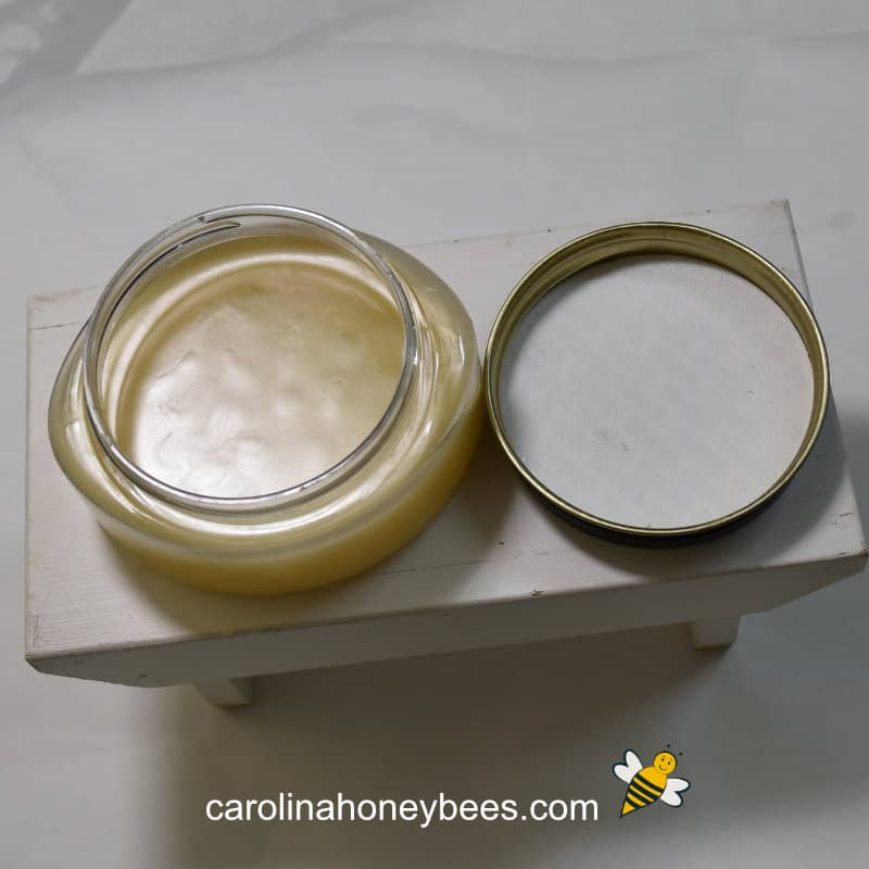Bees wax lotion recipe cooling in a container with lid