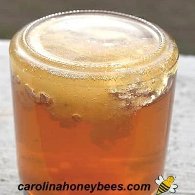 crystallized honey in the bottom of a glass jar
