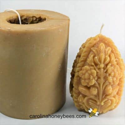 Egg shaped silicone candle mold and beeswax candle image.