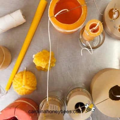 image of various beeswax candle molds with hot beeswax