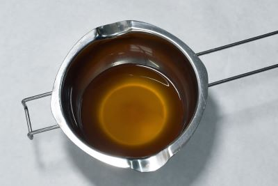 melting beeswax in a double boiler for recipe