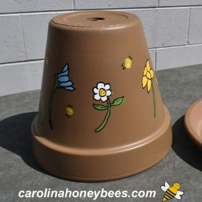 picture of painted clay pot for bee watering station