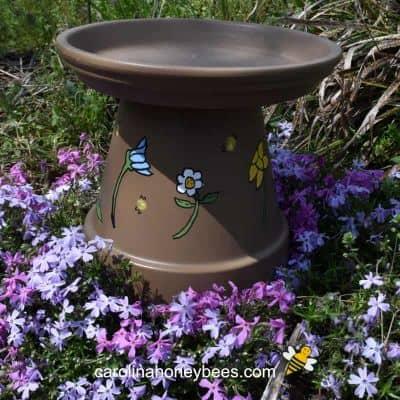 picture of clay pot bee waterer in garden