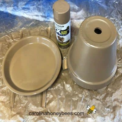 picture of clay pot and saucer painted in base color for bee water station