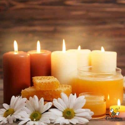 clean burning beeswax candles and pieces of honey comb