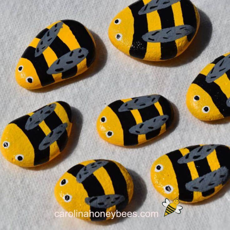 finished painted bee rocks sprayed with sealer