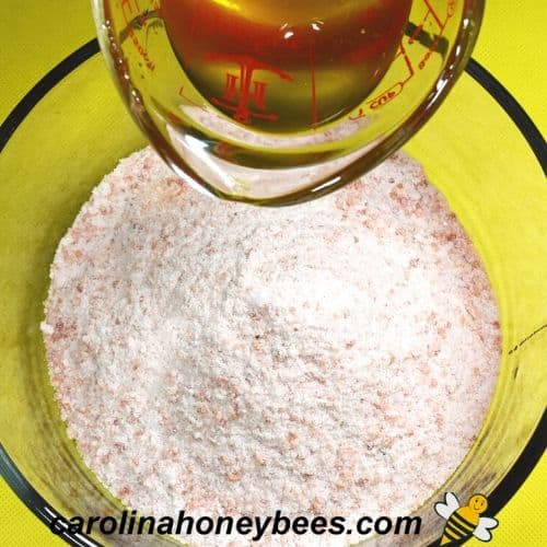 Combine honey oil mixture with salt to make scrub image.