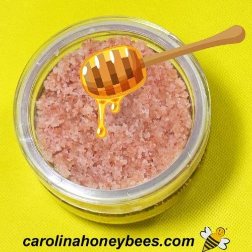 pink sea salt and honey body scrub in container