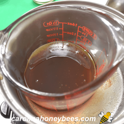 Warming raw honey in a double boiler image.