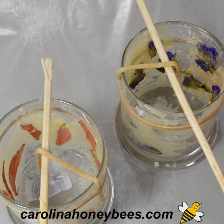 glass jar candles being made with beeswax and flowers