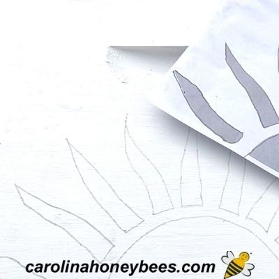 pencil design traced on bee hive box before painting