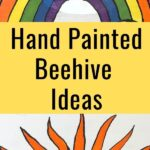 sun and rainbow design painted on bee hive front