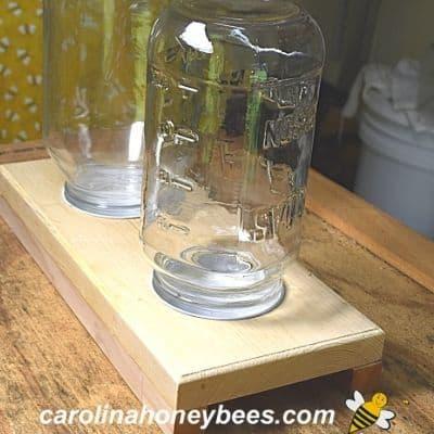 handmade jar feeder that holds 2 quart jars image