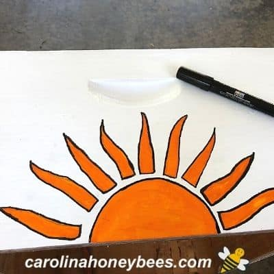 sun drawing on painted bee hive
