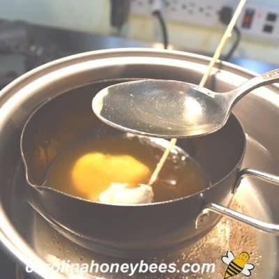 picture of oils being adding to ingredients for food wrap recipe with beeswax