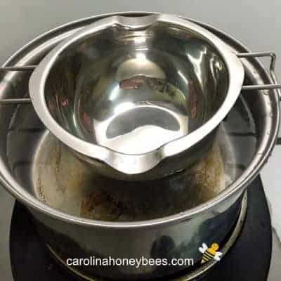 Double boiler insert for melting beeswax for making melts image.
