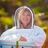 beekeeper charlotte with bee suit