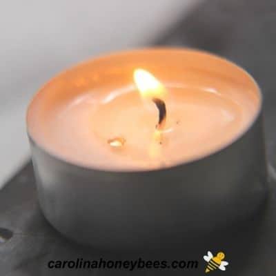 Tealight wick burning image.