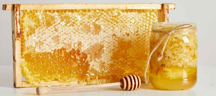 image of a frame of raw honey in the comb and in a jar ready to use