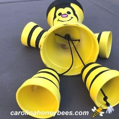 image of clay pot bee craft being assembled with feet and legs