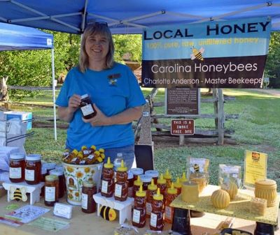 picture of me selling honey at a local event