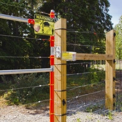 image of a strong electric fence with warning signs