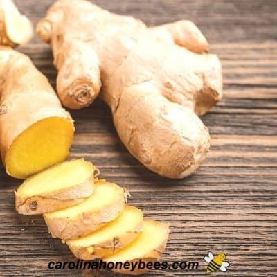 Peeled ginger to use in honey lemon recipe image.