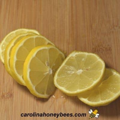 Sliced lemon to use in infused honey image.
