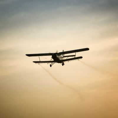 Aerial mosquito spraying at dusk image.