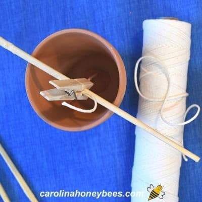 Beeswax Citronella candle wick secured on both ends image.