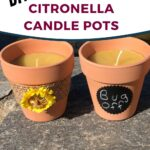 Clay pot beeswax citronella candles sitting on rock shelf image.