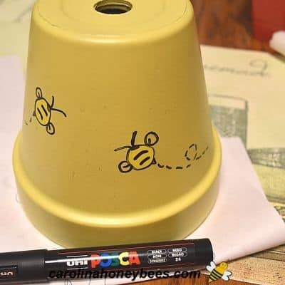 Bee theme design painted on clay pot base image.