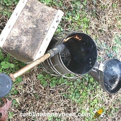 Using a propane torch to clean out a baked on soot image.