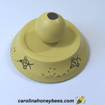 Clay saucer decorated with bees for candy dish lid image.