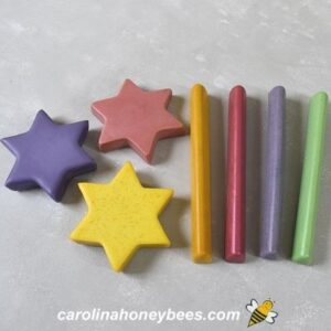Homemade beeswax crayons in stick and star shapes.