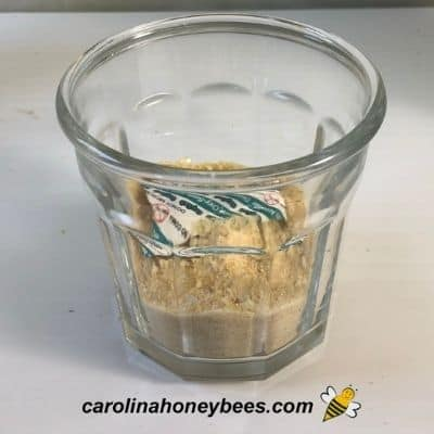 Container of honey powder made using dehydrator image.