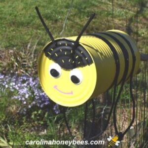 Finished bee craft project made from tin can image.