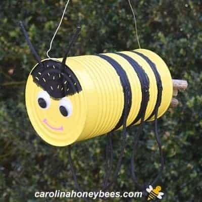 Honey bee craft project made from tin can image.