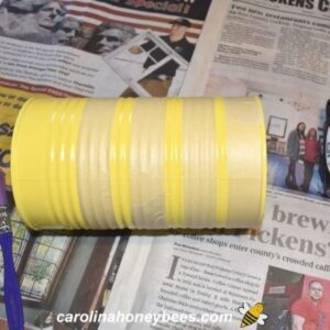 Rows of masking tape on can to simulate stripes of a bee image.