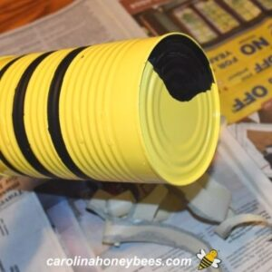 Tin can bee project with stripes and head image.