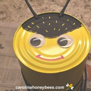 Tin can bee fact with yellow markings image.