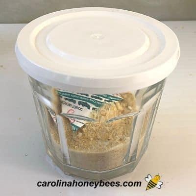Sealed jar of honey powder image.