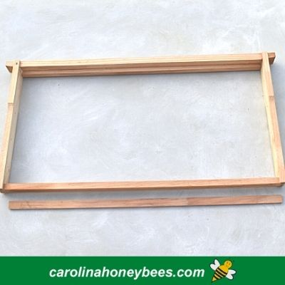 Final assembled bee hive frame with extra strip image.