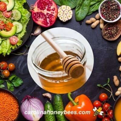 Jar of honey surrounded by vegan approved foods image.