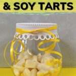Homemade beeswax and soy tarts in a gift jar with bow image.