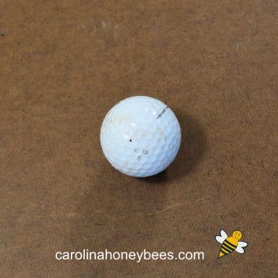 Old white golf ball image.